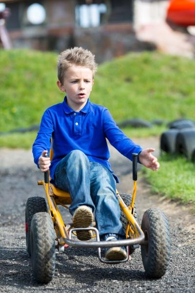 boy driving moon buggy