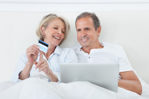 happy couple online shopping