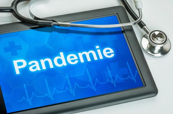 tablet mit dem text pandemie auf