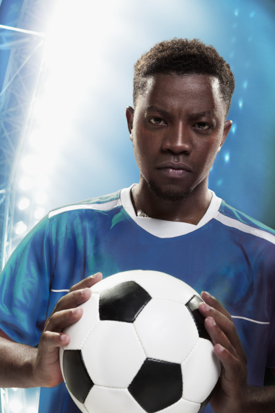 athlet mit fussball