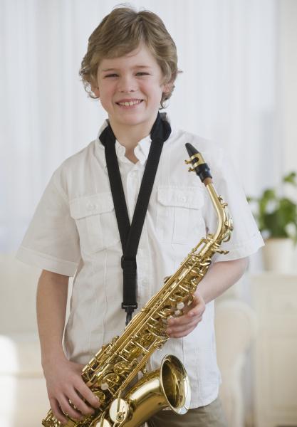 boy holding saxophon