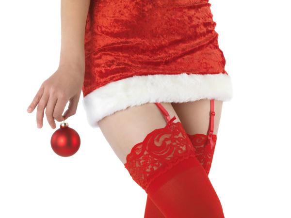 frau im sexy weihnachts outfit halt