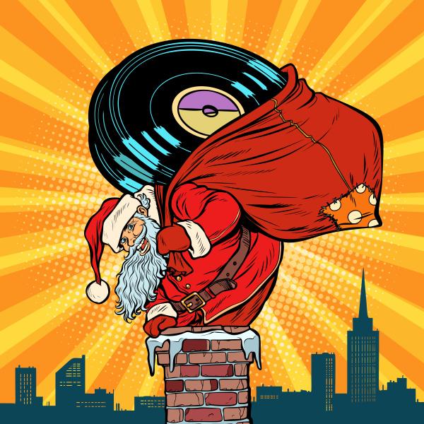 weihnachtsmann mit vinyl schallplatten steigt in
