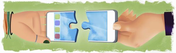 haende die zwei teile eines mobiltelefons