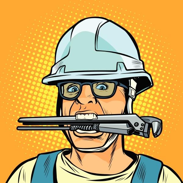 lustige arbeitenprofessionelle klempner mit einem schraubenschluessel