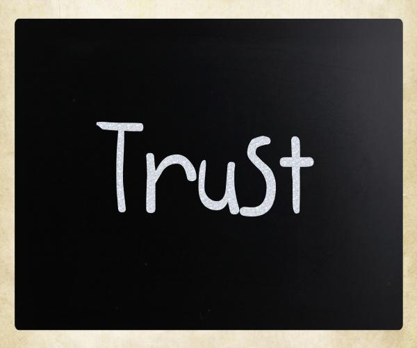 das wort vertrauen handschriftlich mit weisser