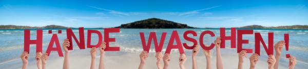 menschen haende halten wort haende waschen