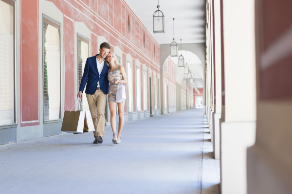 romantic, couple, with, shopping, bags, walking - 28745329