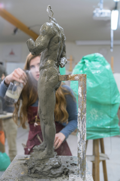 female, student, spraying, water, on, sculpture - 28749456