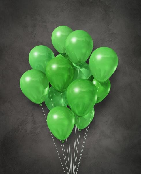 gruene luftballons gruppe auf einem konkreten