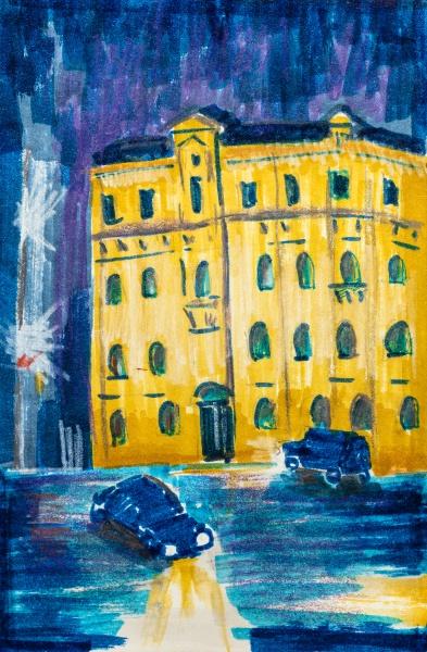 nachtstadtbild mit gelbem apartmenthaus