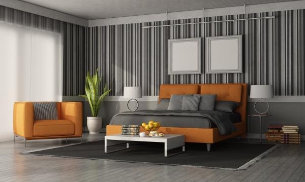 modernes schlafzimmer mit doppelbett und sessel