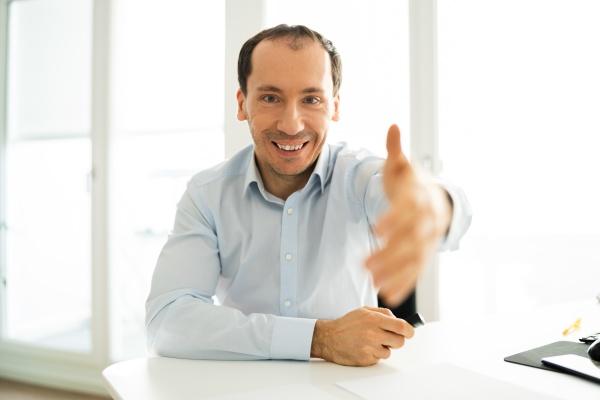 executive man welcoming handshake
