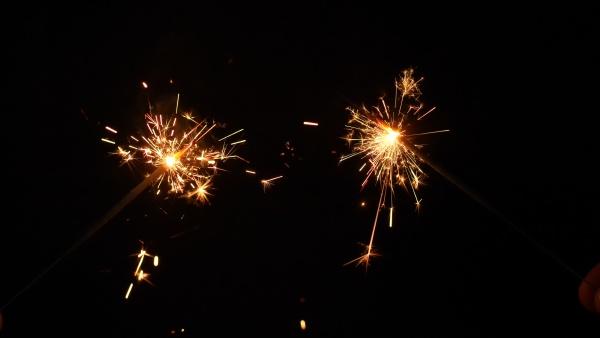 sparkling stars burning on black