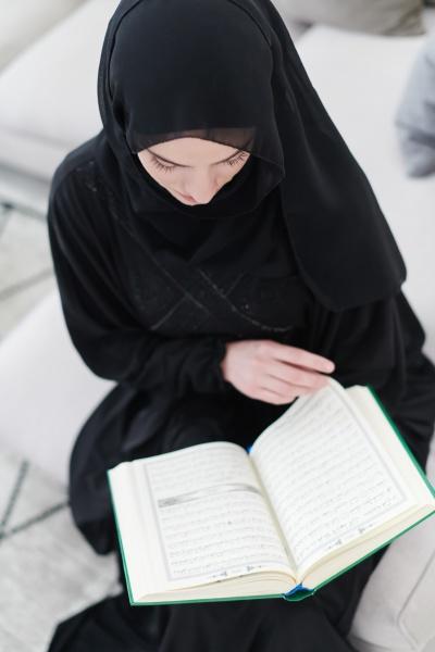 young, muslim, woman, reading, quran, at - 29806045
