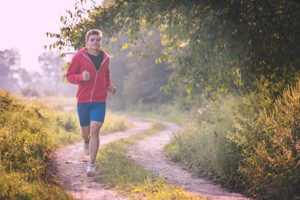 man, jogging, along, a, country, road - 30031316