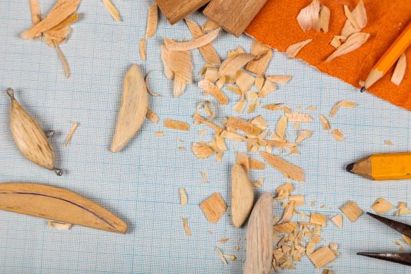 handgefertigtes angeln aus holz tacles millimeterpapierhintergrund