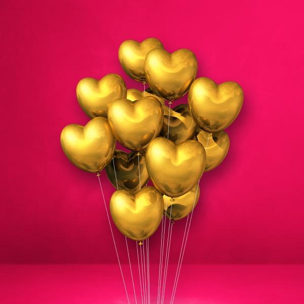 goldene herzform ballons buendeln auf einem
