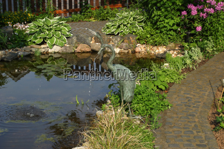 edged with plants garden pond