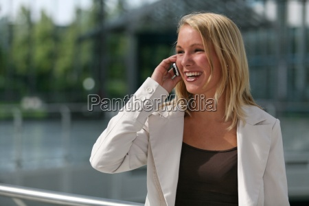 young woman laughing with phone