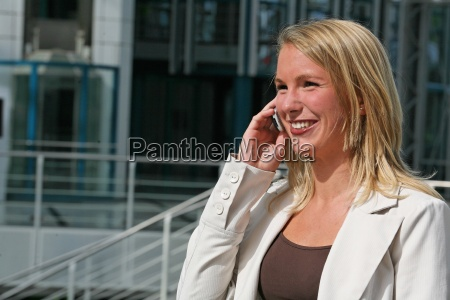 young woman smiling with phone