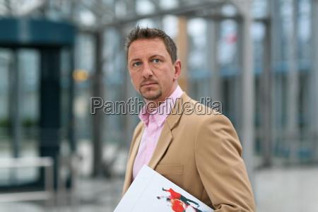 teacher with folders