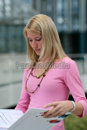 young woman studying documents