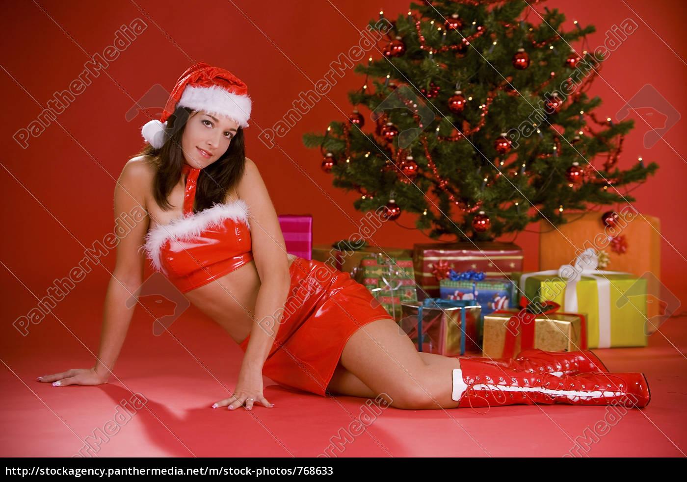 sexy weihnachtsfrau vor baum stockfoto 768633. Black Bedroom Furniture Sets. Home Design Ideas