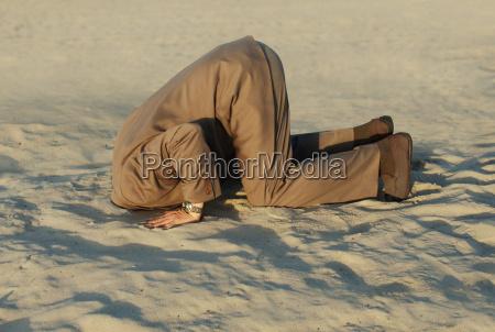 den kopf in den sand stecken