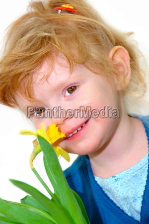little girl smells of daffodil