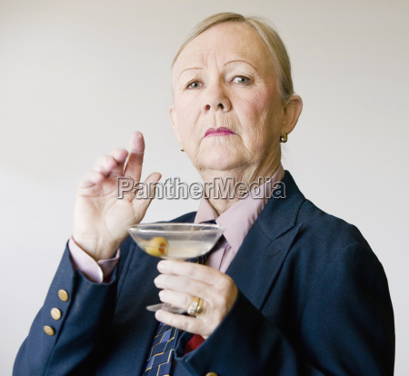 dramatic senior woman with a martini