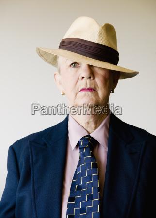 dramatic senior woman wearing a hat