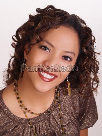 young hispanic woman portrait big smile