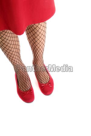 womans leg with fishnet