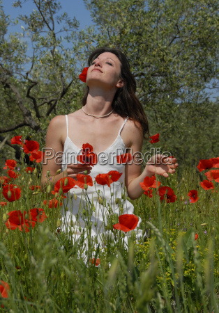 young woman in poppies