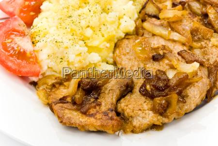 steak vom schweinefleisch geroestet auf z