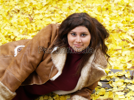 young large woman with yellow leaves