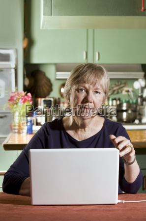senior woman with a laptop computer