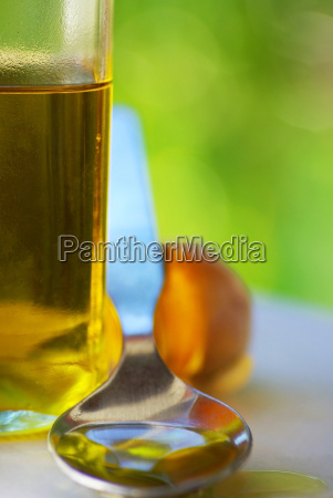spoon and bottle of olive oil