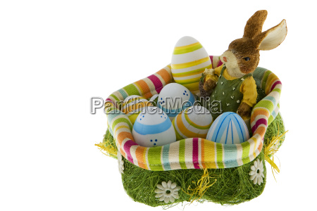 easter bunny with eggs in nest