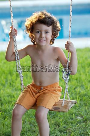 beautiful child in swing