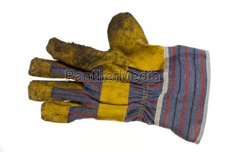 einzelner schmutziger arbeitshandschuh
