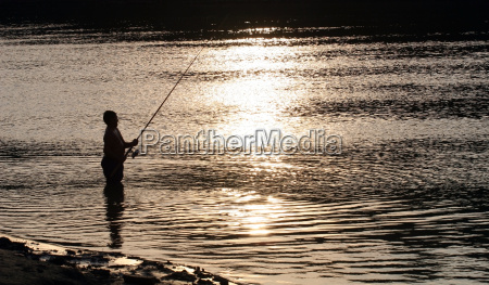 fisherman silhouette catching fish