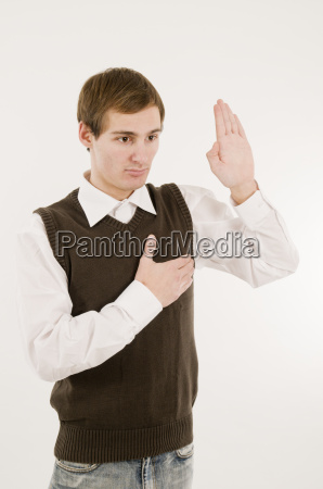young man take an oath side
