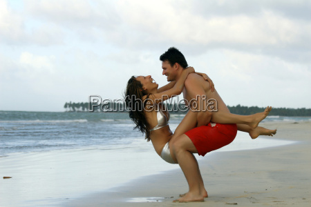 fun couple on the beach