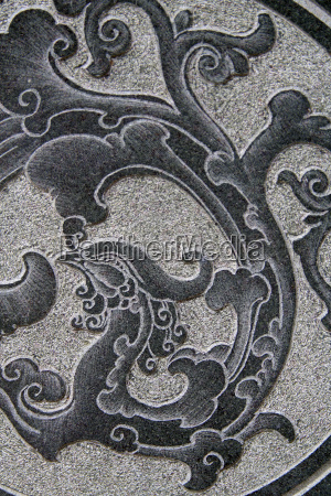 asian pattern on a stone wall