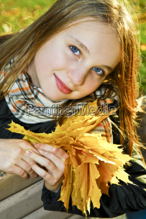teenage girl in the fall