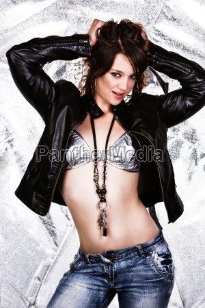 woman in leather jacket bra and