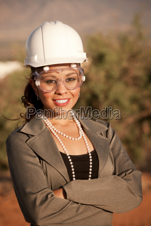 young woman in hard hat and