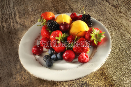 plate of fruit on wood